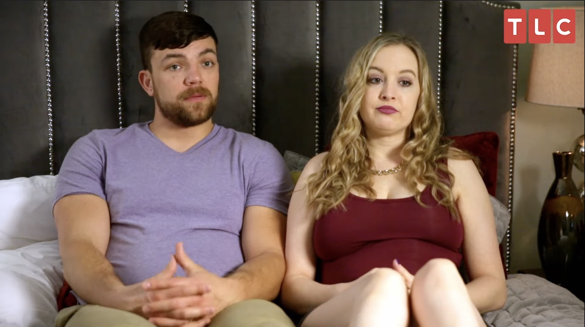 90 Day Fiancé stars Andrei Castravet and Elizabeth Potthast talk to producers on a bed
