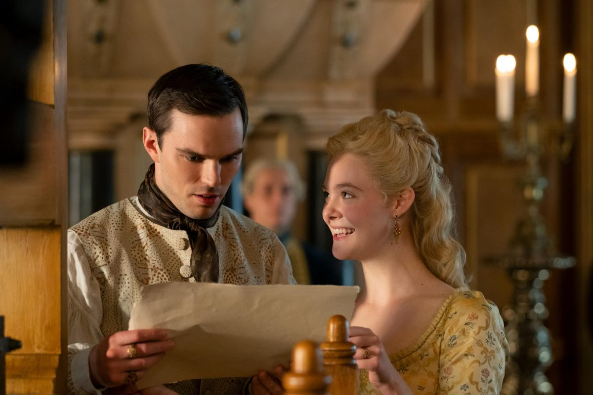Elle Fanning and Nicolas Hoult with a letter on The Great