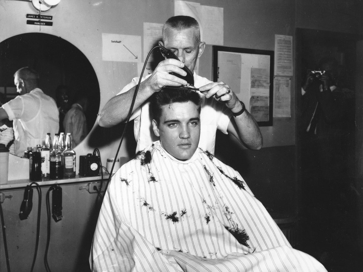 Elvis Presley at the barber getting a haircut as part of his stint in the U.S. Army in 1959