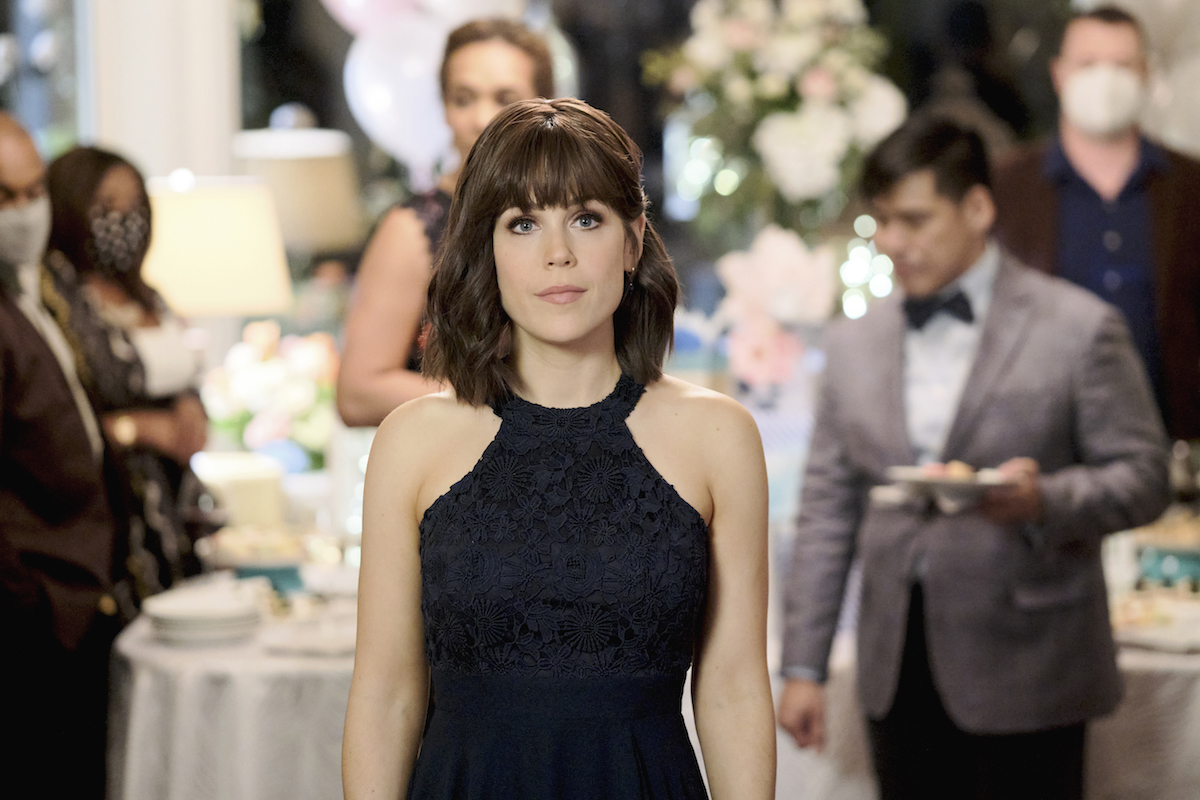 Erin Krakow with bangs and wearing a black halter dress in It Was Always You