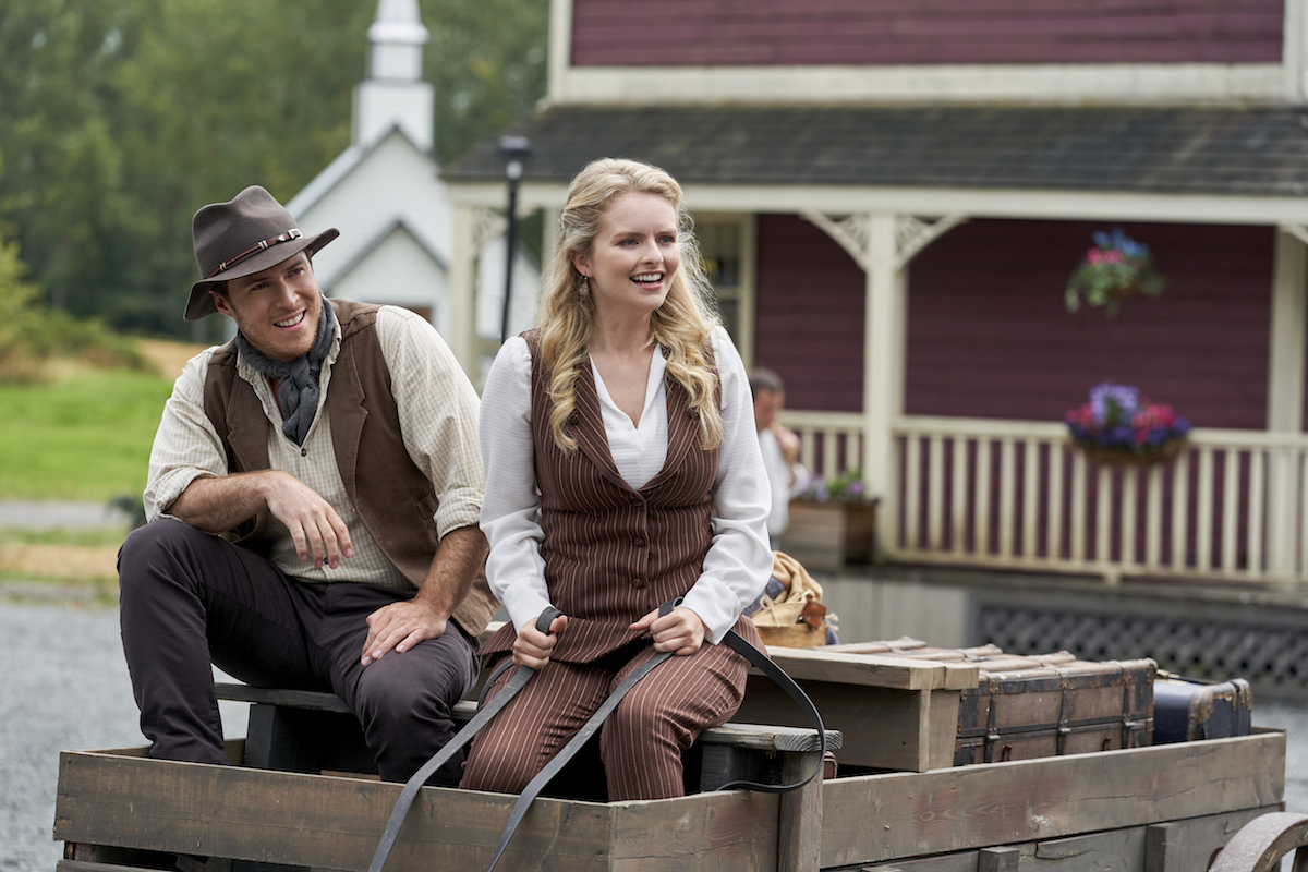 Faith sitting next to a man in a wagon in When Calls the Heart season 8 premiere episode