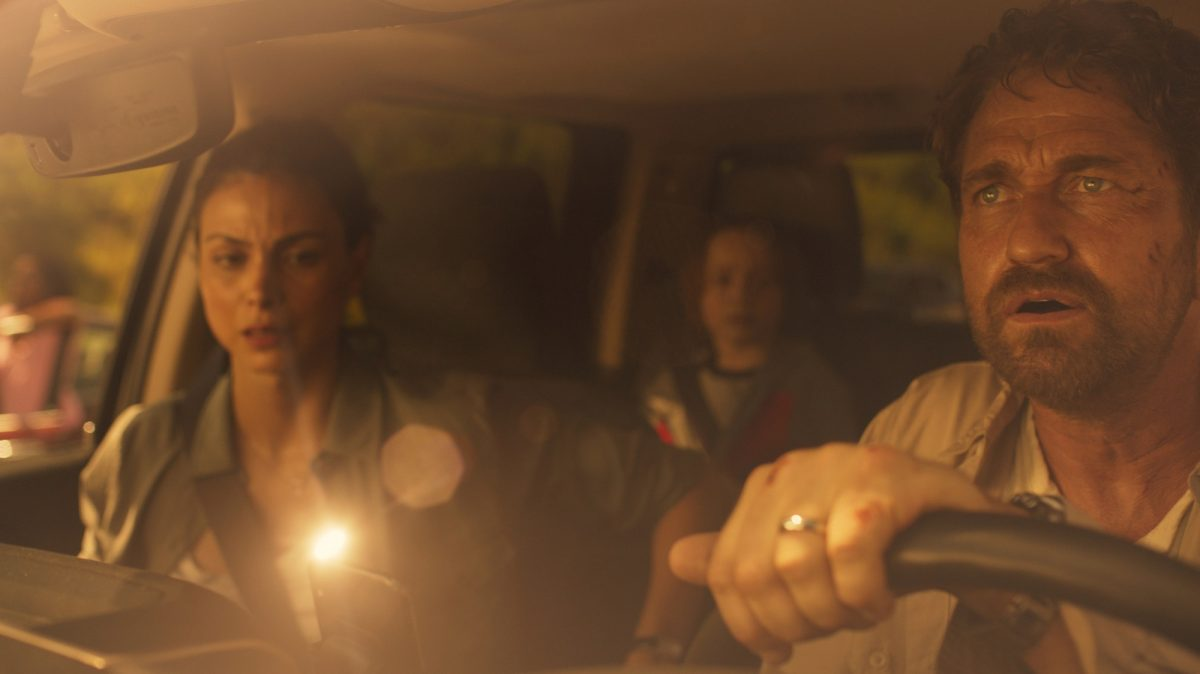 Gerard Butler, Morena Baccarin and Roger Dale Floyd drive together in a car