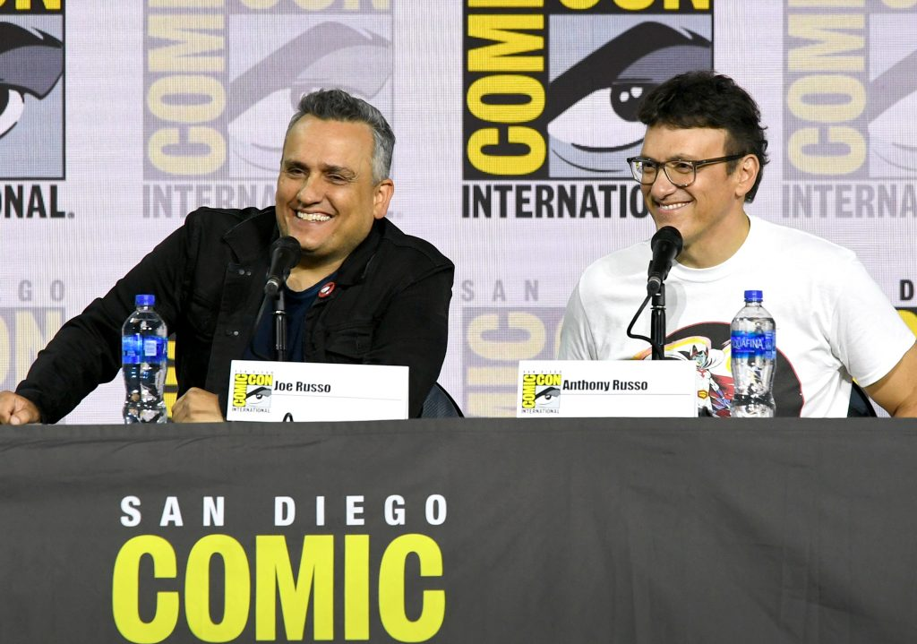 """Joe Russo and Anthony Russo speak at the Writing """"Avengers: Endgame"""" Panel during 2019 Comic-Con International."""