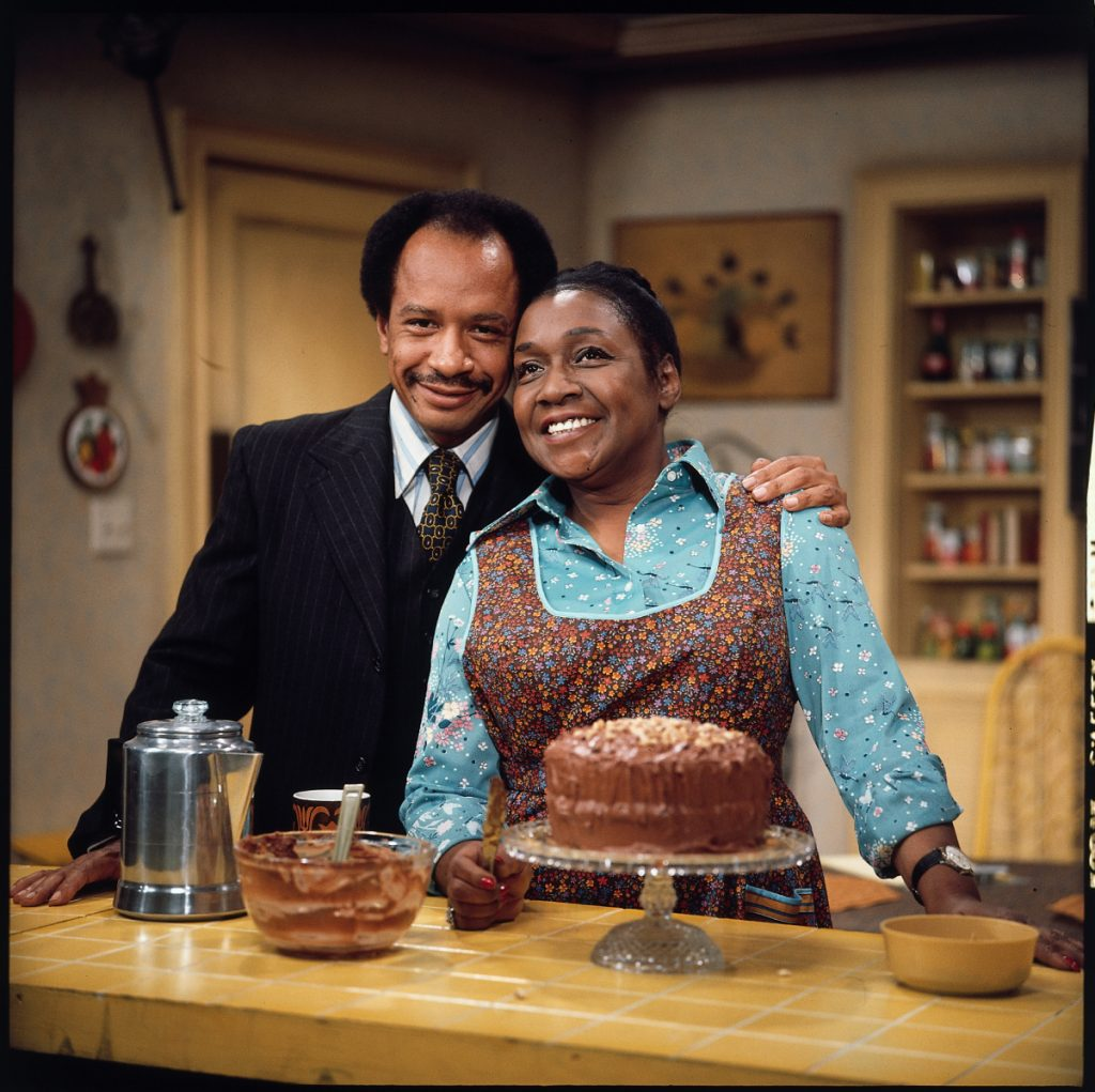 (L to R) Sherman Helmsley as George Jefferson and Isabel Sanford as his wife Louise Jefferson on 'The Jeffersons'
