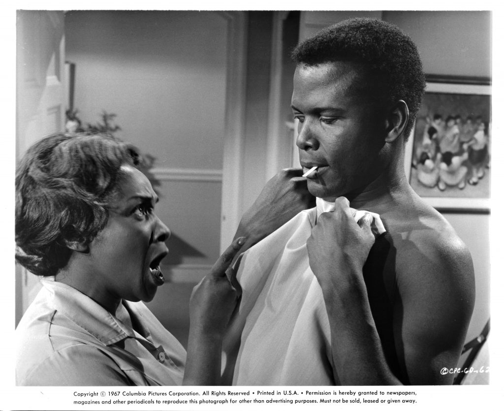 Actors Isabel Sanford and Sidney Poitier in a scene from the 1967 film 'Guess Who's Coming to Dinner'