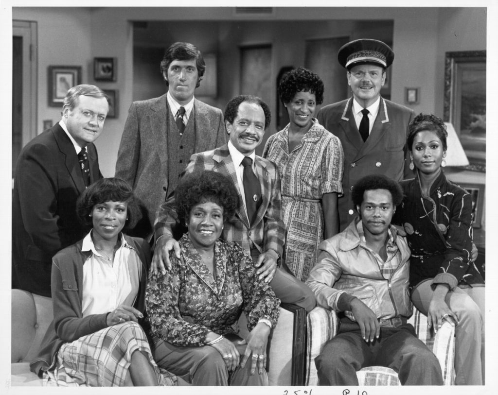 The cast of the TV sitcom 'The Jeffersons' (L-R Back Row: Franklin Cover, Paul Benedict, Sherman Hemsley, Marla Gibbs, Ned Wertimer and Berlinda Tolbert, Front Row, seated: Roxie Roker, Isabel Sanford, and Mike Evans circa 1975