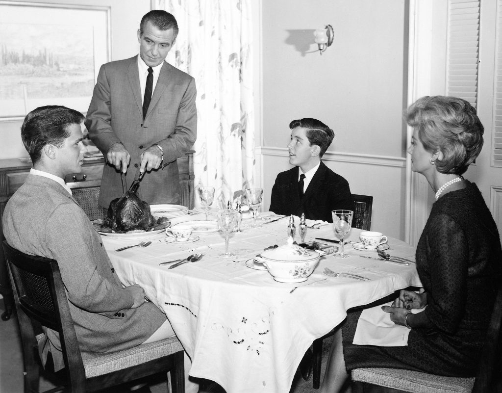 The cast of 'Leave It to Beaver': Tony Dow, Hugh Beaumont, Jerry Mathers, and Barbara Billingsley dressed formally in a dinnertime scene