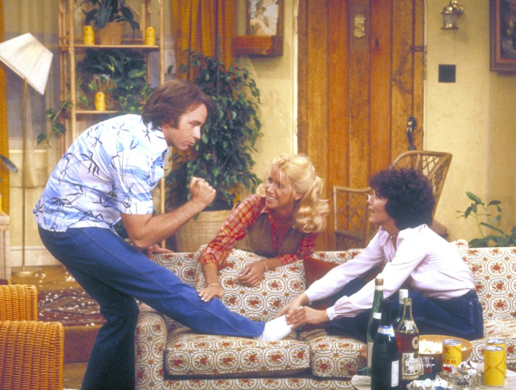 John Ritter as Jack Tripper, Suzanne Somers as Chrissy Snow, and Joyce DeWitt as Janet Wood in a scene from 'Three's Company', 1977