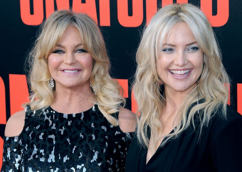 Goldie Hawn and Kate Hudson smile on the red carpet of the 'Snatched' premiere at the Regency Village Theatre on May 10, 2017 in Westwood, California | Barry King/Getty Images