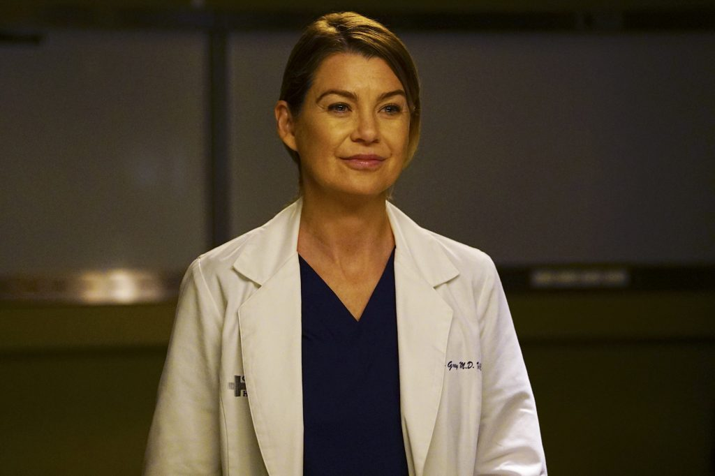 Ellen Pompeo as Meredith Grey smiling in front of a blurred background
