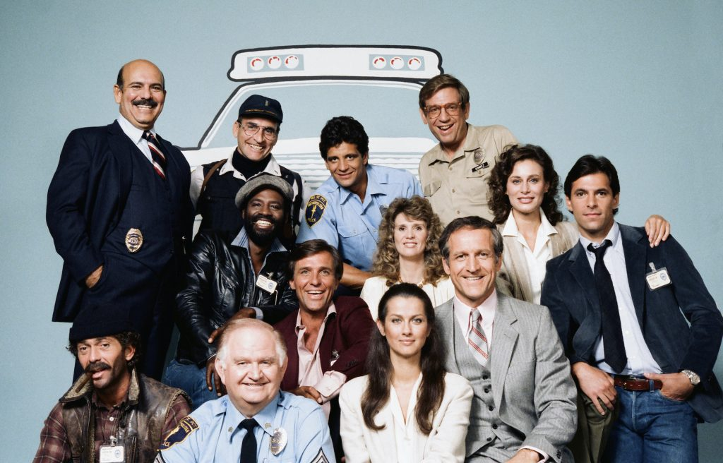 Cast of 'Hill Street Blues' in front of a light blue background with an illustration of a police car outline