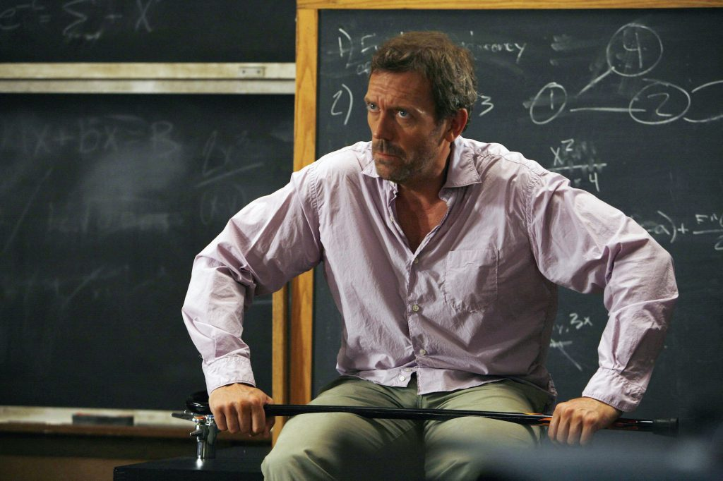 Hugh Laurie as Dr. Greg House, looking to the side
