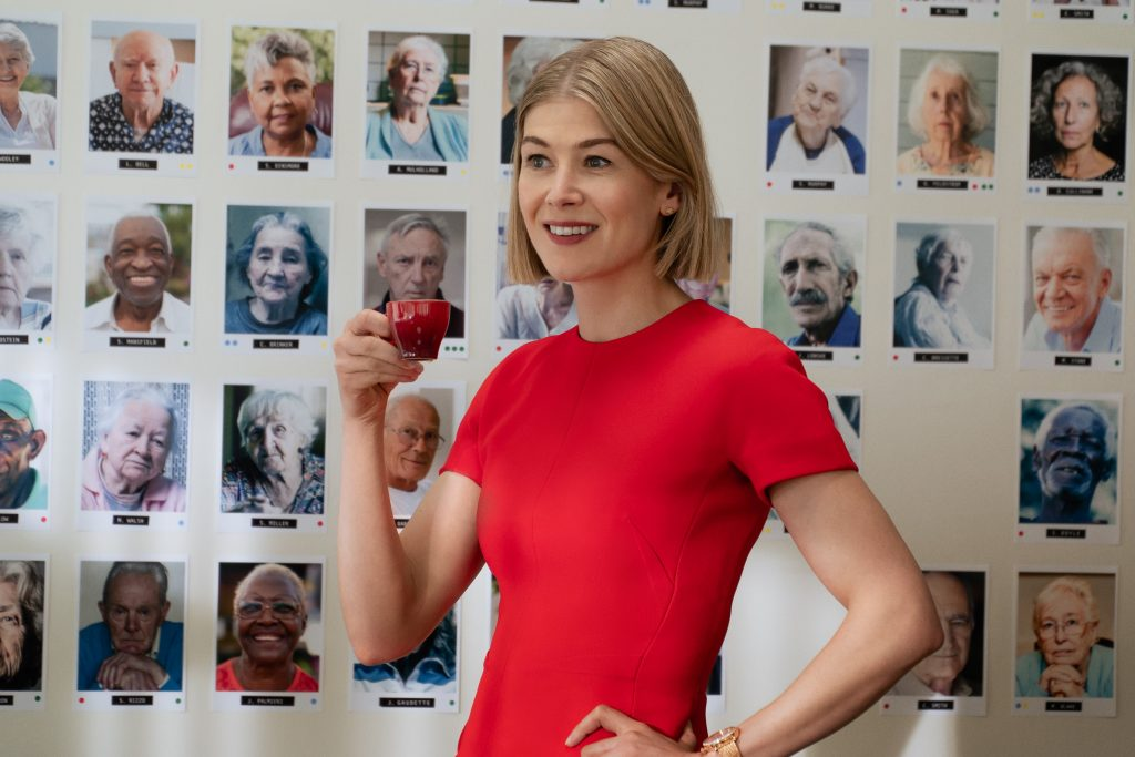 Marla Grayson (Rosamund Pike) amidst all her victims in 'I Care a Lot.'