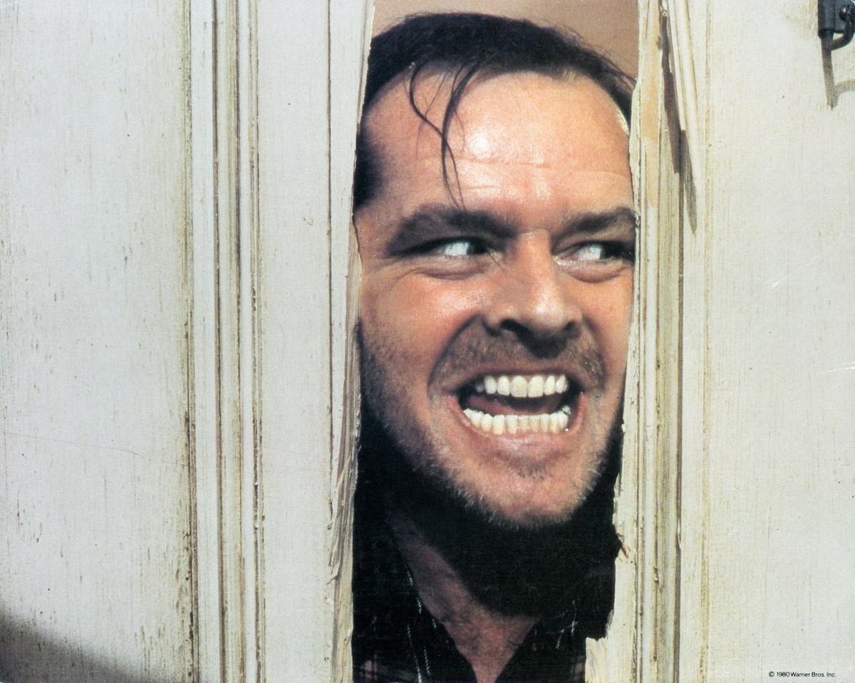 Jack Nicholson peering through the door in 'The Shining'