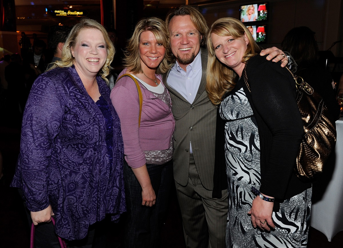 Janelle, Meri, Kody, and Christine Brown of 'Sister Wives' smiling together at an event in Las Vegas in 2012