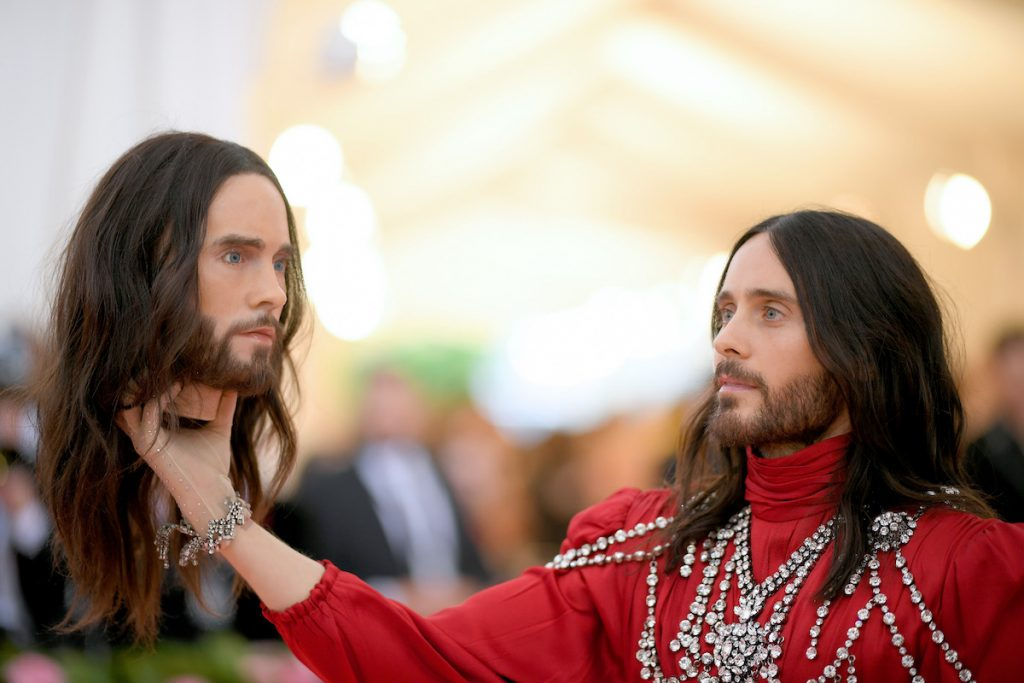 Jared Leto holds a replica of his own head as he arrives at the 2019 Met Gala Celebrating Camp: Notes on Fashion at the Metropolitan Museum of Art on May 6, 2019, in New York City.