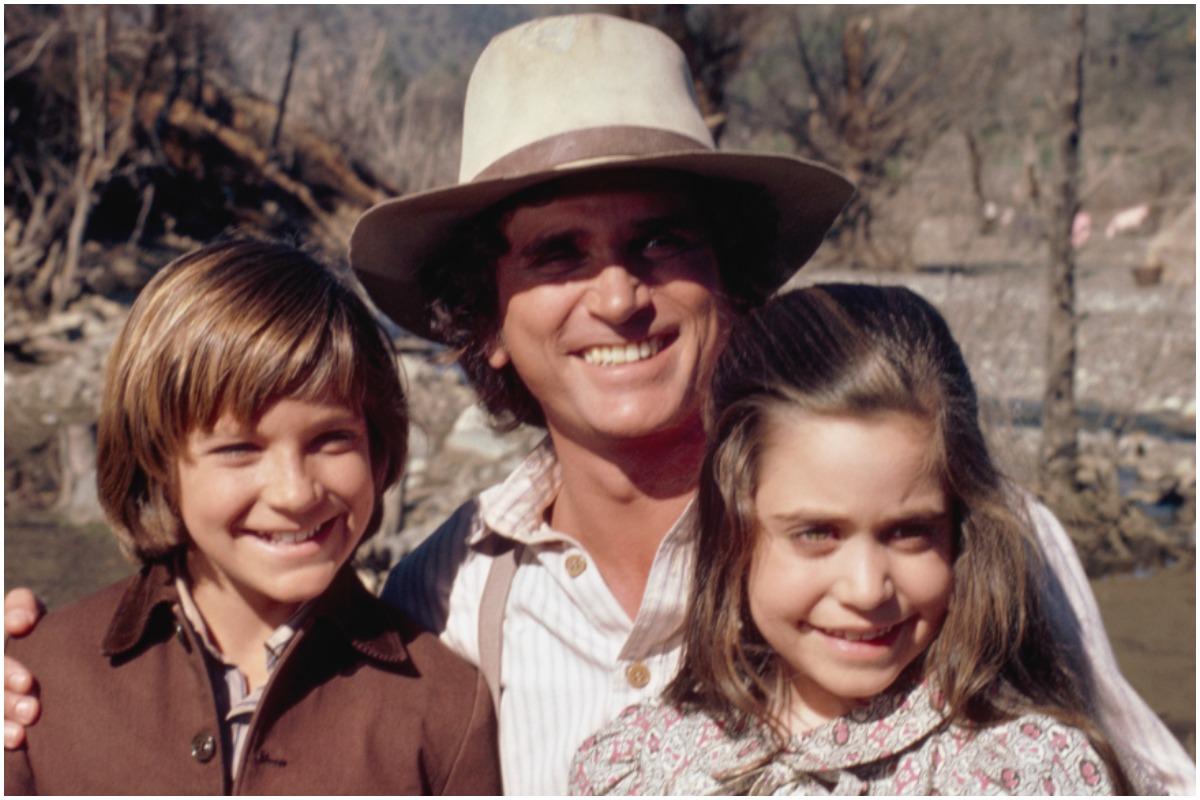'Little House on the Prairie' star Jason Bateman, Michael Landon, and Melissa Francis smiling outside.