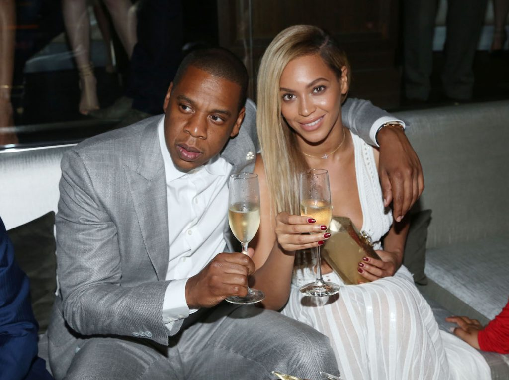 Jay-Z and Beyonce with champagne glasses