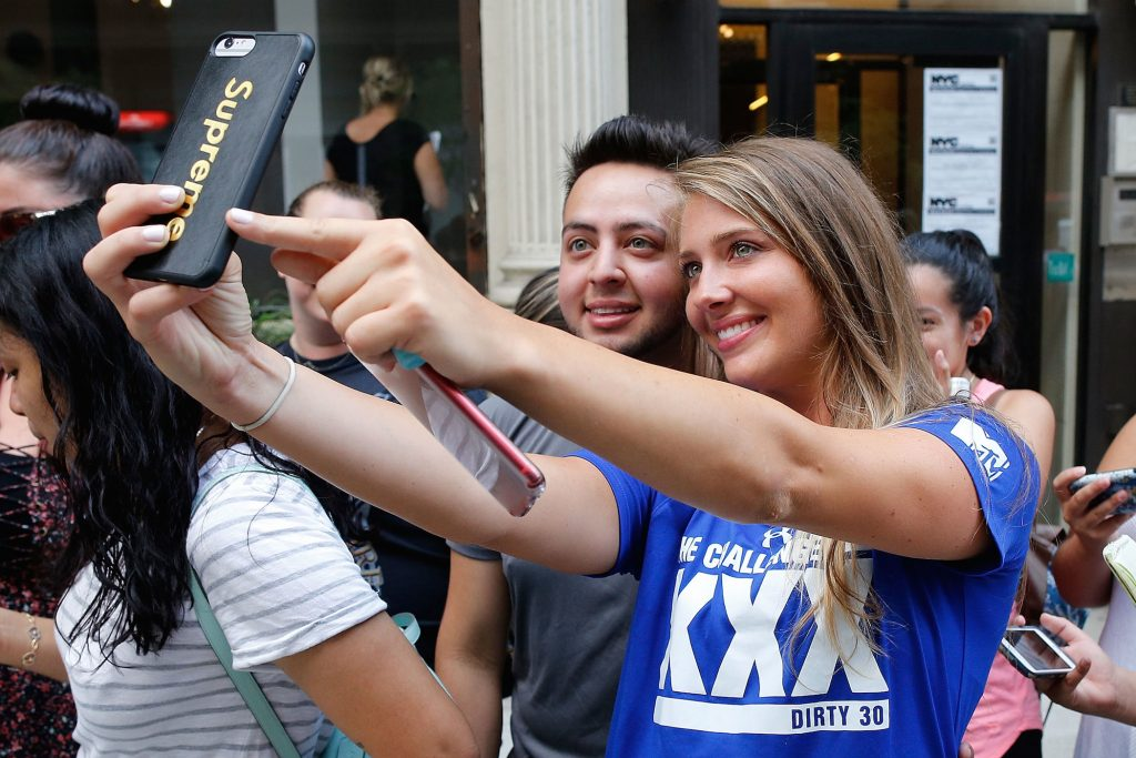Jenna Compono from MTV's 'The Challenge' taking a selfie with a fan