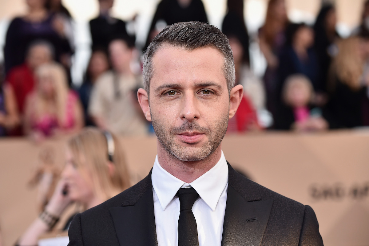 Jeremy Strong poses for photographers as he walks the red carpet at the 2016 Screen Actors Guild Awards