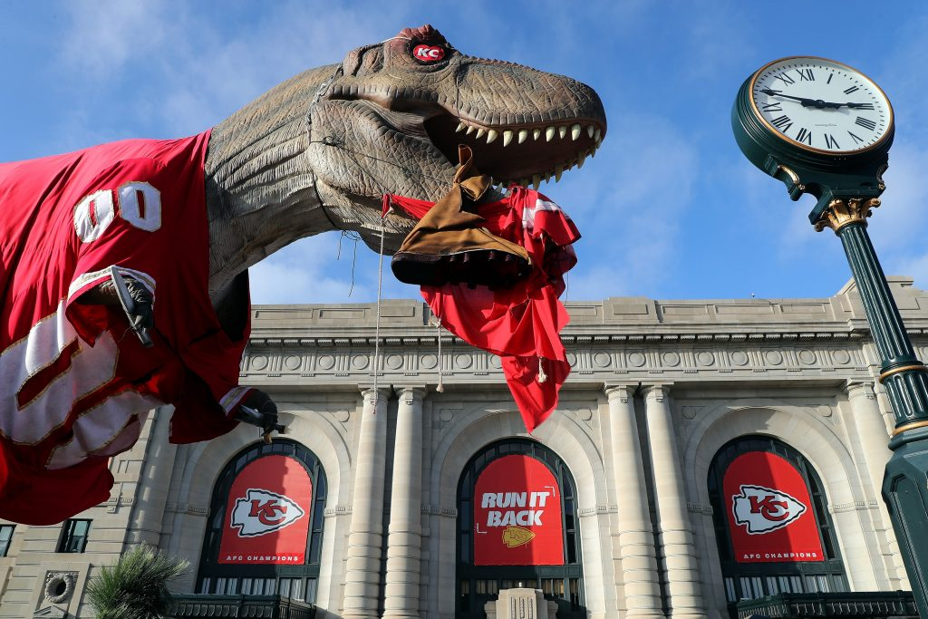 Super Bowl LV Kansas City Chiefs Dinosaur holding a Tampa Bay Buccaneers Jersey in its mouth