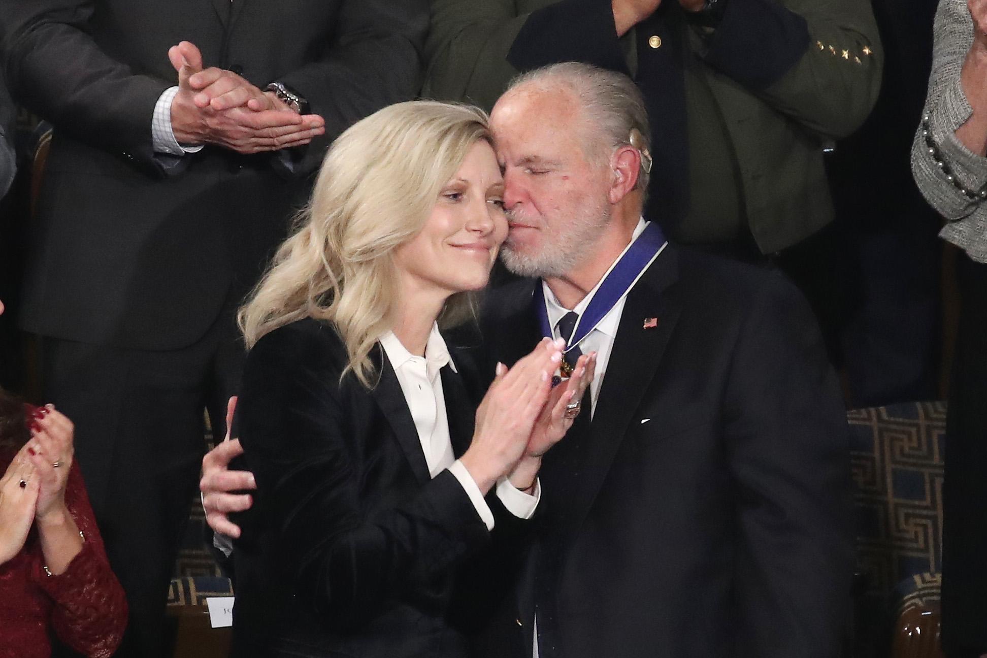 Rush Limbaugh embraces his wife, Kathryn Adams Limbaugh