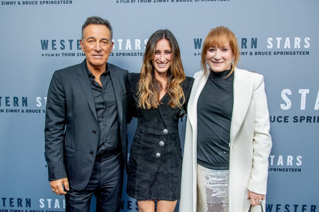 (L to R): Bruce Springsteen,  Jessica Rae Springsteen, and Patti Scialf smiling  at Western Stars screening