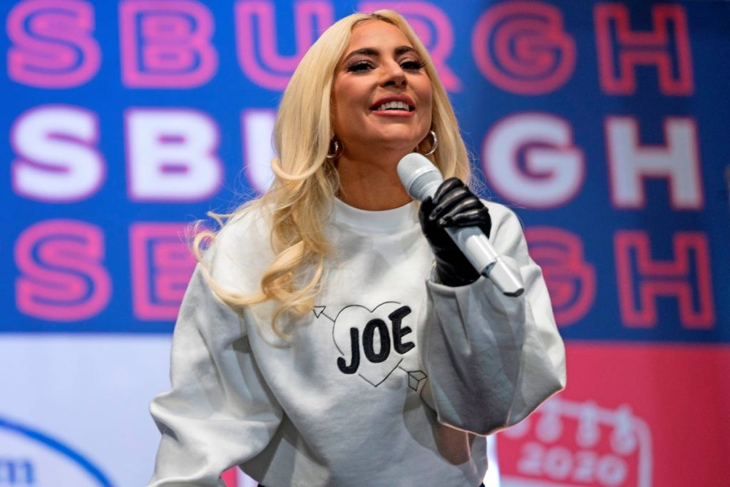 Lady Gaga sings wearing a Joe Biden sweater during a Drive-In Rally at Heinz Field in Pittsburgh, Pennsylvania
