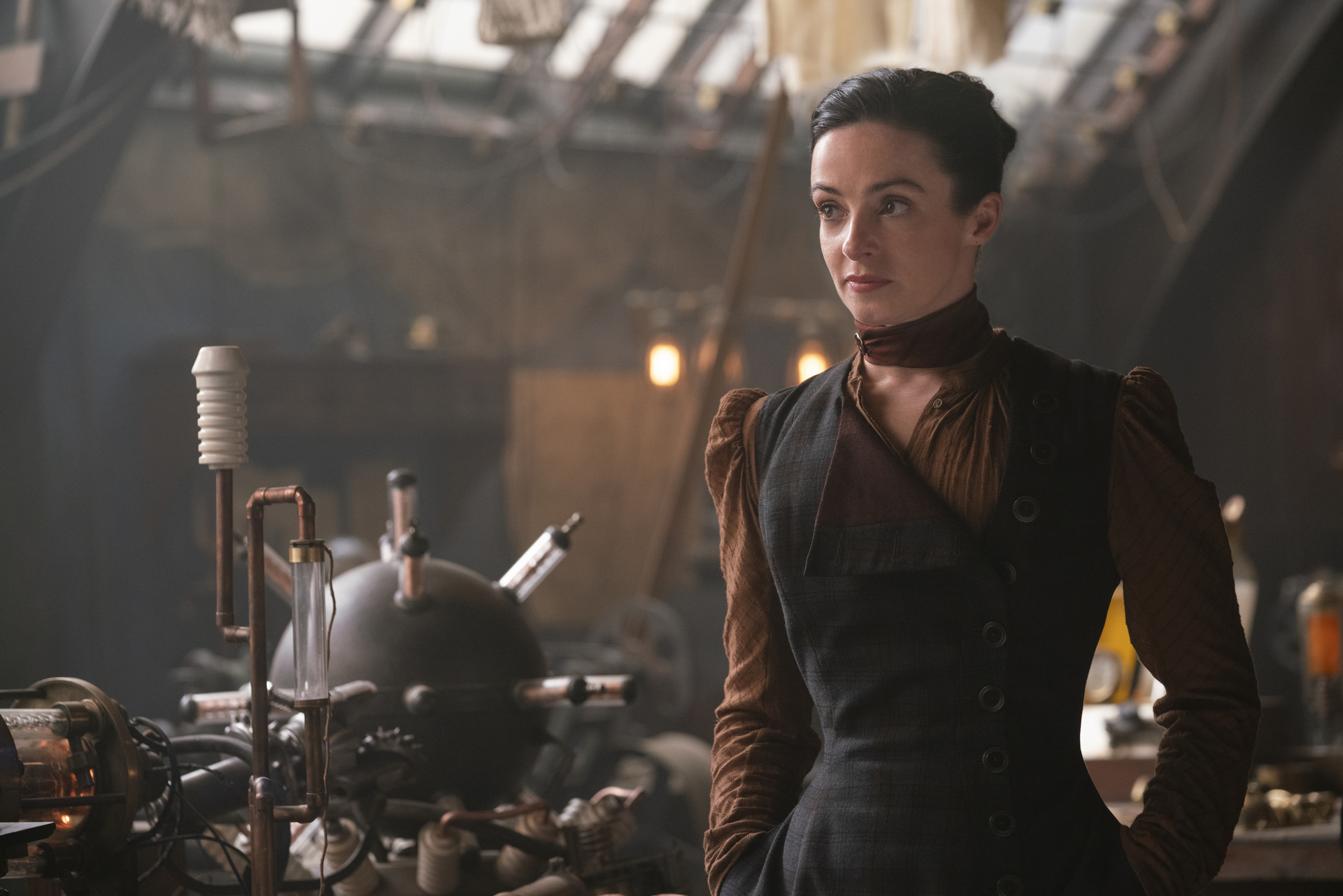 Laura Donnelly in black and brown dress in The Nevers