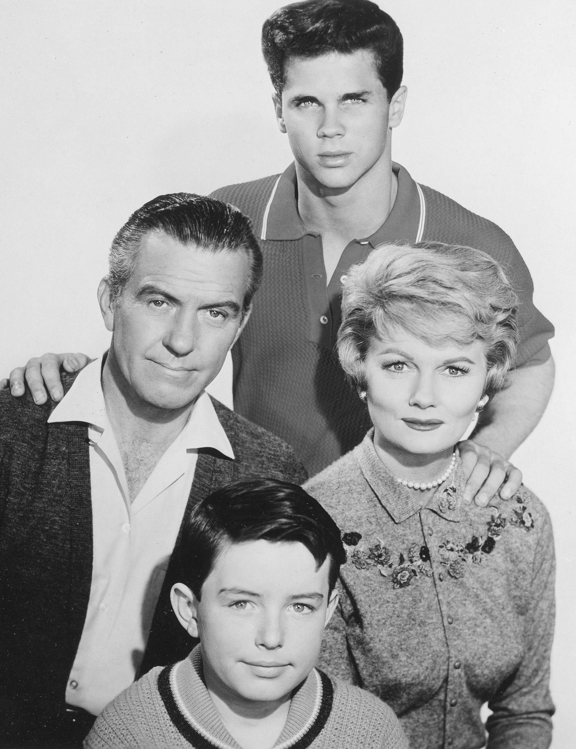 Jerry Mathers as Beaver Cleaver, Hugh Beaumont as Ward Cleaver, Barbara Billingsley as June Cleaver and Tony Dow as Wally Cleaver in a promotional photo for 'Leave It to Beaver'
