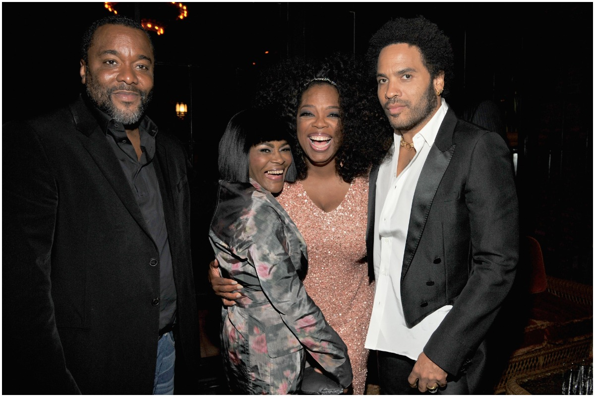 Lee Daniels, Cicely Tyson, Oprah Winfrey, and Lenny Kravitz pose and smile at an event.