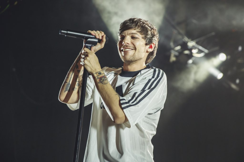 Why are fans 'proud' of Louis Tomlinson
