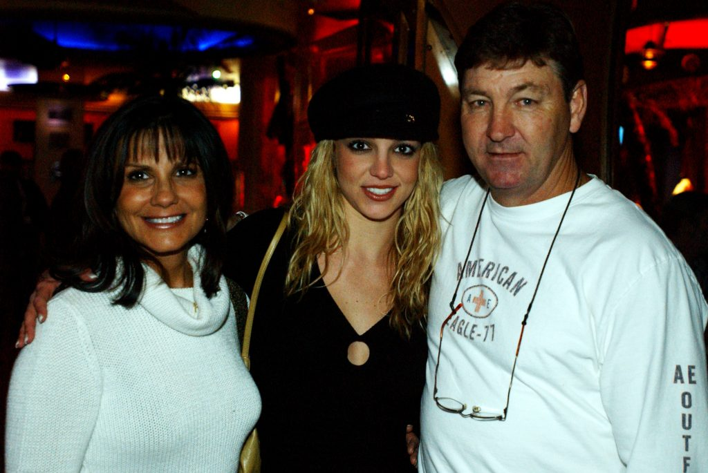 Lynne Spears, Britney Spears, and Jamie Spears smiling at Planet Hollywood.