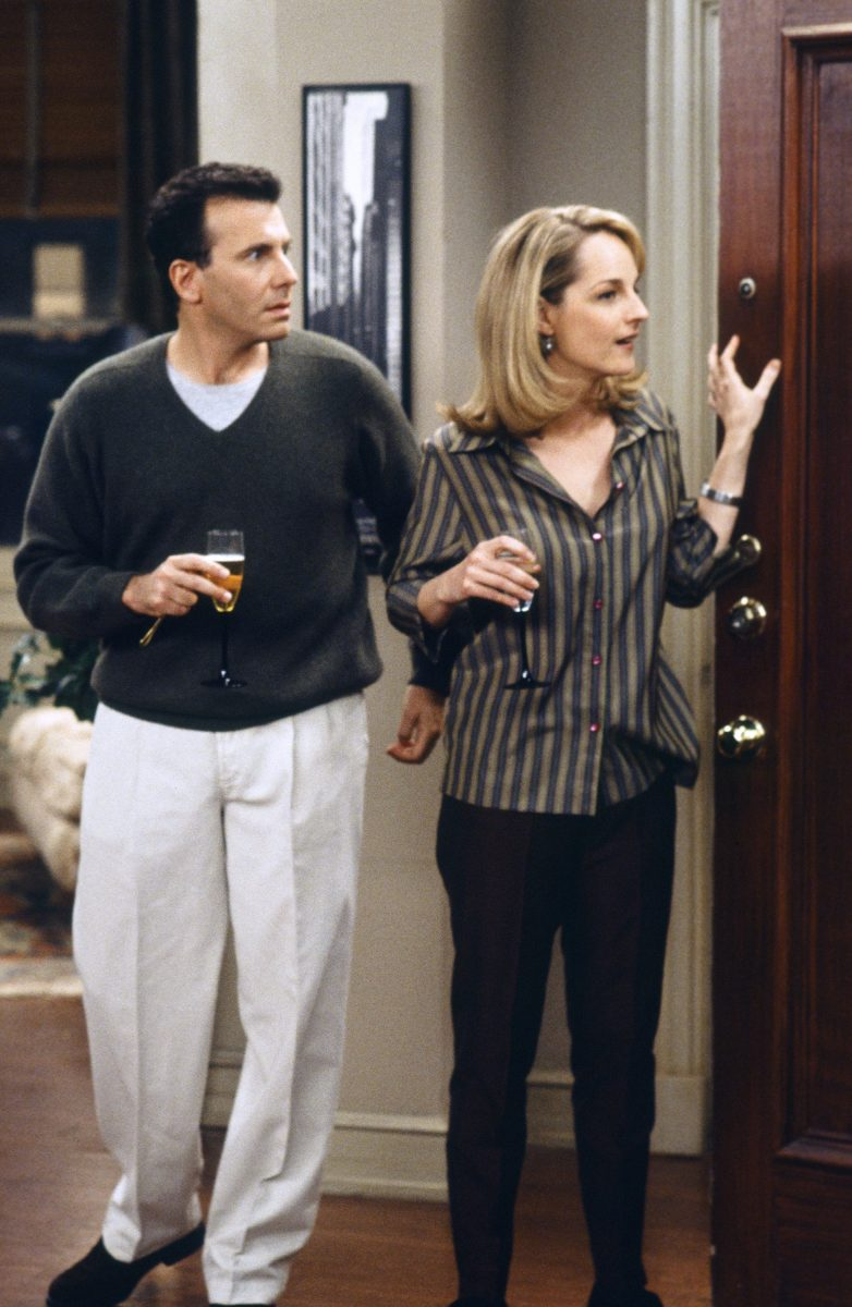 Paul Reiser and Helen Hunt stand on the set of 'Mad About You'