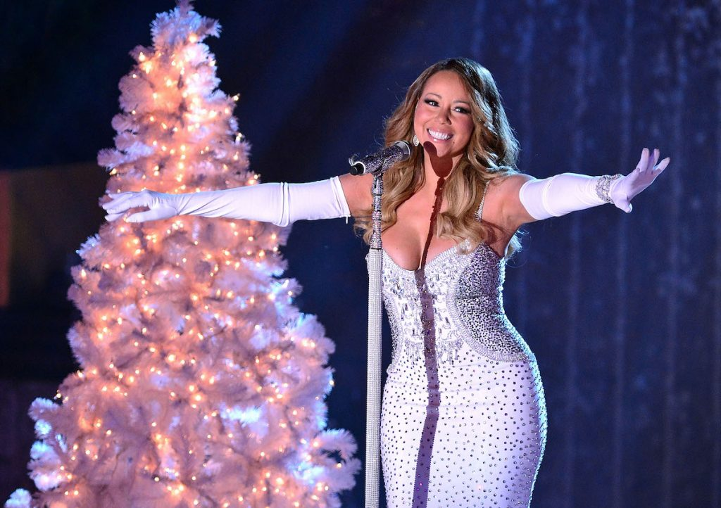 Mariah Carey performs at the 81st Annual Rockefeller Center Christmas Tree Lighting Pre-Tape at Rockefeller Center on December 3, 2013 in New York City | James Devaney/WireImage