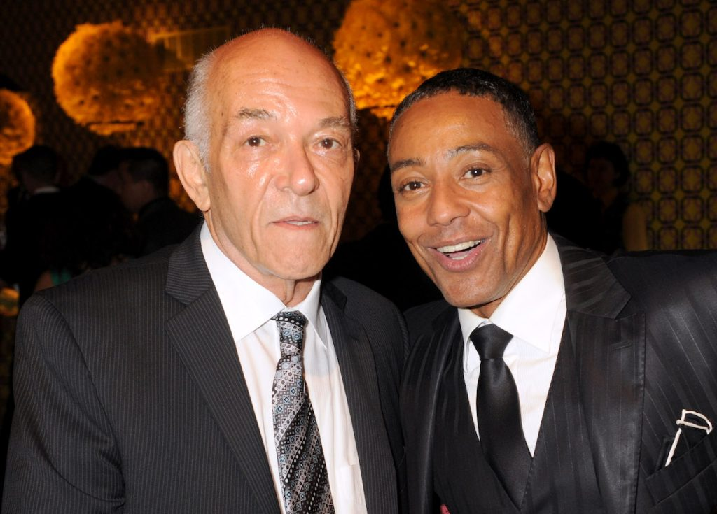 Mark Margolis and Giancarlo Esposito look at the camera dressed in suits