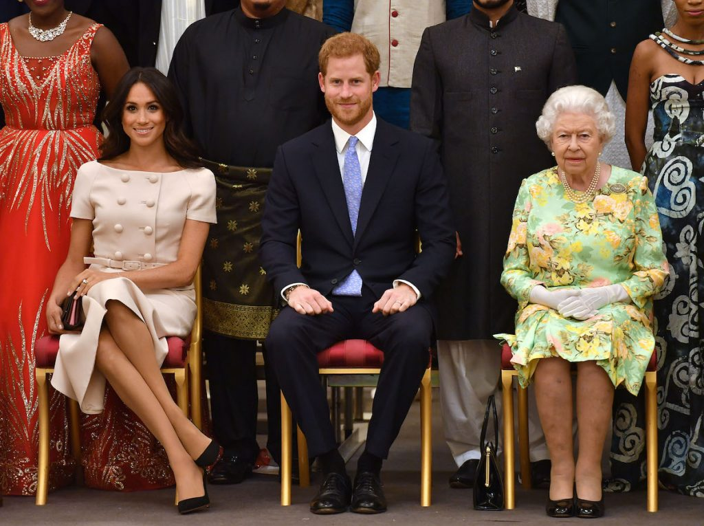 Meghan Markle, Prince Harry, and Queen Elizabeth at the Queen's Young Leaders Awards Ceremony at Buckingham Palace on June 26, 2018