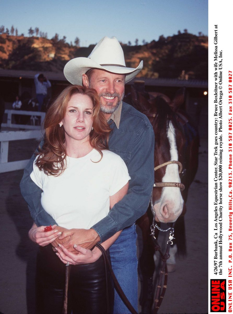 Melissa Gilbert in a white shirt and Bruce Boxleitner at the Los Angeles Equestrian Center.