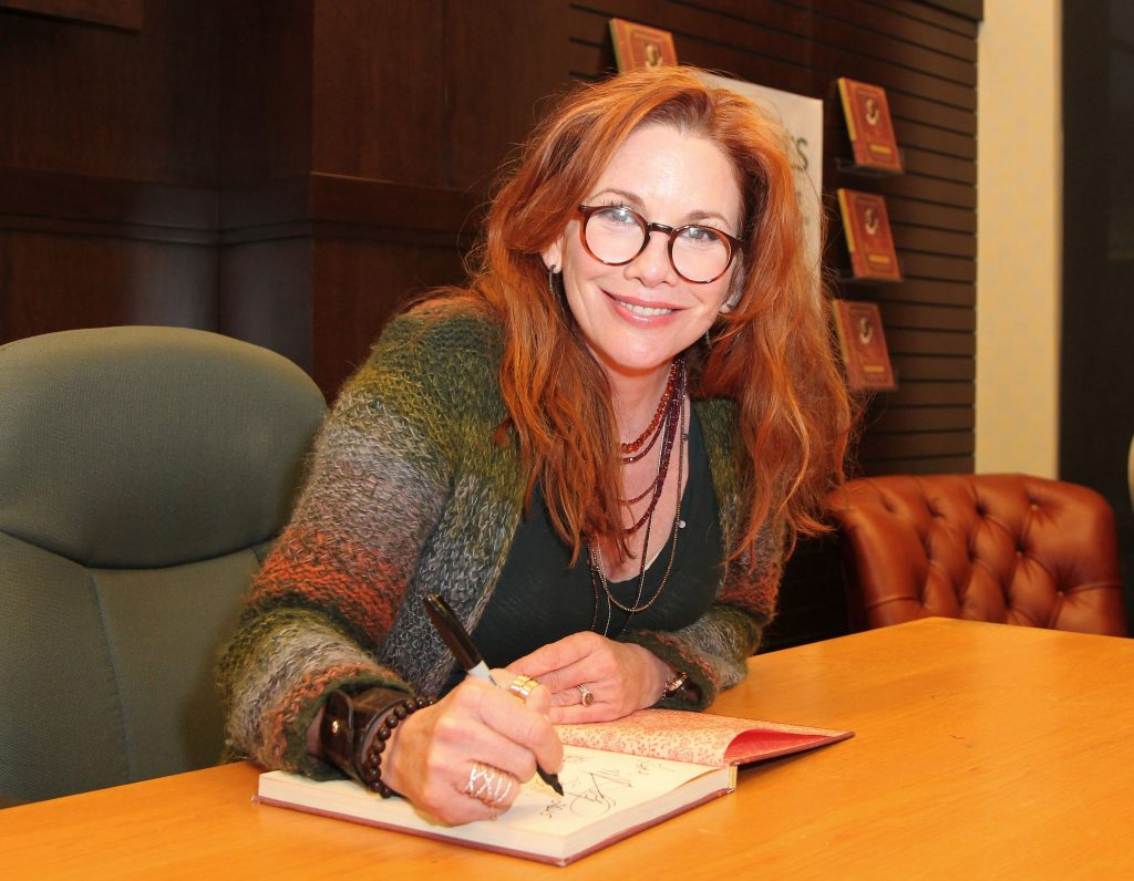 Melissa Gilbert of 'Little House on the Prairie' signs copies of her book 'My Prairie Cookbook' at Barnes & Noble bookstore at The Grove