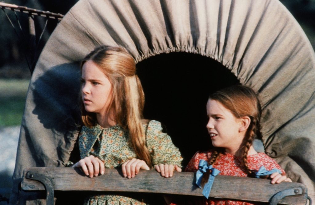 Melissa Sue Anderson in a green dress/Melissa Gilbert in a red dress on the set of 'Little House on the Prairie'