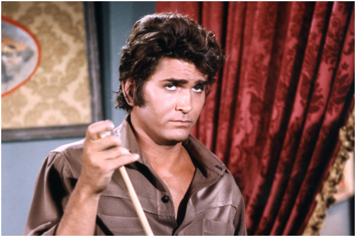 Michael Landon (1936-1991), US actor, wearing a brown shirt and grey trousers, chalking a pool cue, in a publicity portrait issued for the US television series, 'Bonanza', USA, circa 1970. The western series starred Landon as 'Joseph 'Little Joe' Cartwright'.