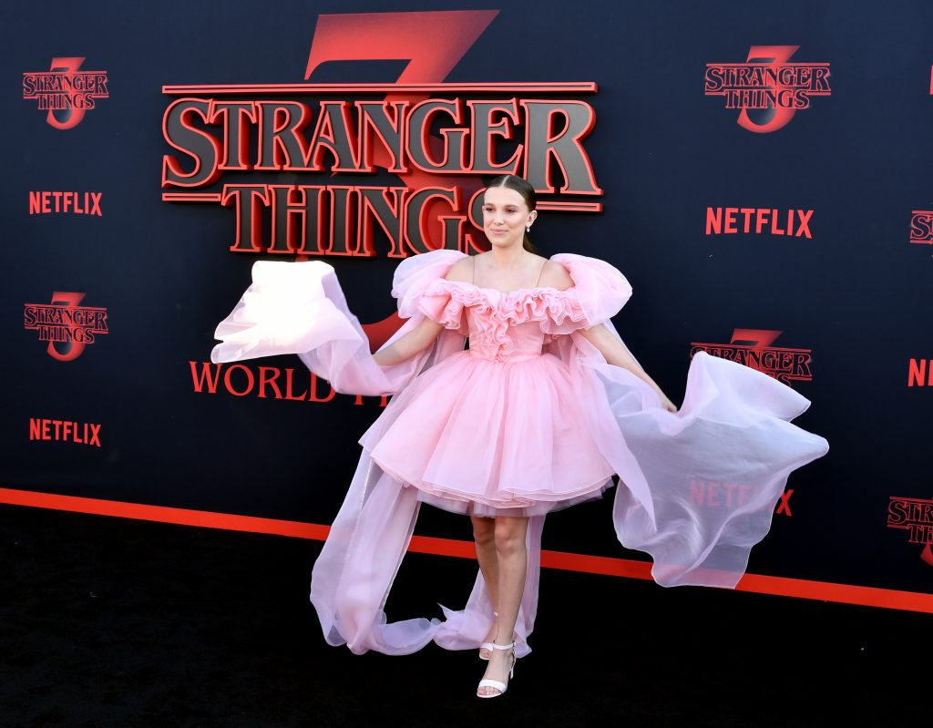 Millie Bobby Brown attends the premiere of Netflix's 'Stranger Things' Season 3 in Pink Dress