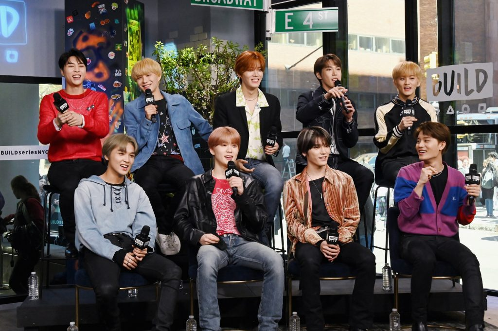Johnny, Jungwoo, Yuta, Doyoung, Mark, Haechan, Jaehyun, Taeyong, and Taeil of NCT 127 take part in a Build Series interview in 2019