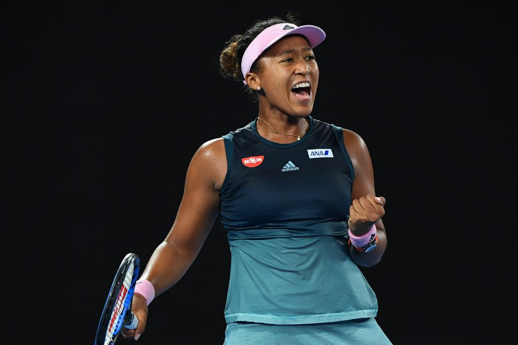 Naomi Osaka celebrates win after match in 2019