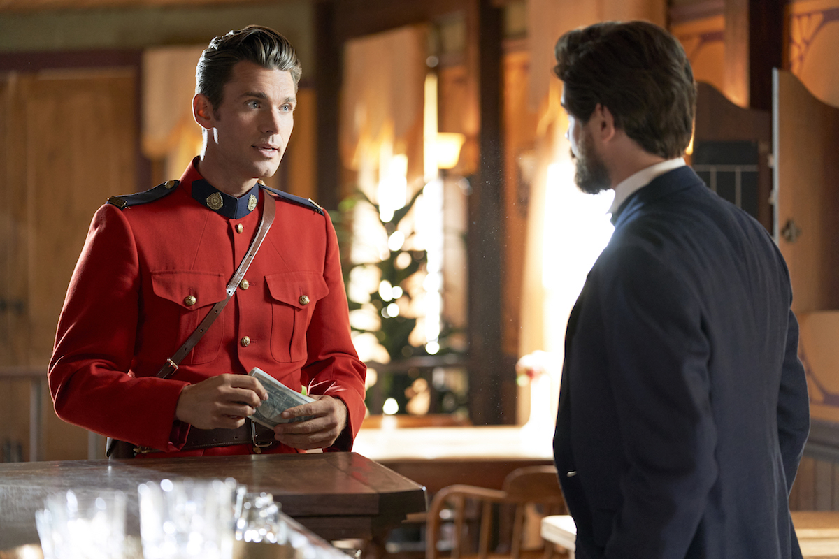 Kevin McGarry as Nathan Grant, wearing a red jacket and talking to another man, in 'When Calls the Heart'