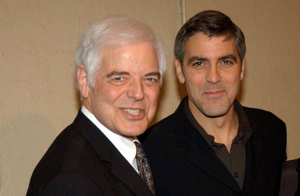George Clooney and his father, Nick Clooney, pose for cameras at the premiere of 'Confessions of a Dangerous Mind' in 2002