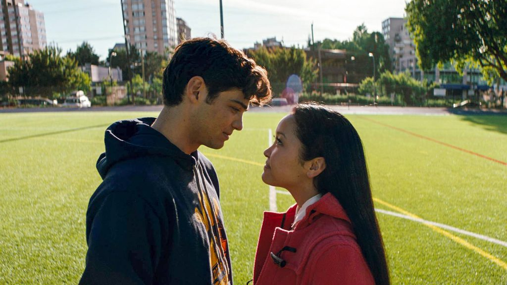 Noah Centineo as Peter Kavinsky and Lana Condor as Lara Jean Covey almost kissing at the lacrosse field on 'To All the Boys I've Loved Before'