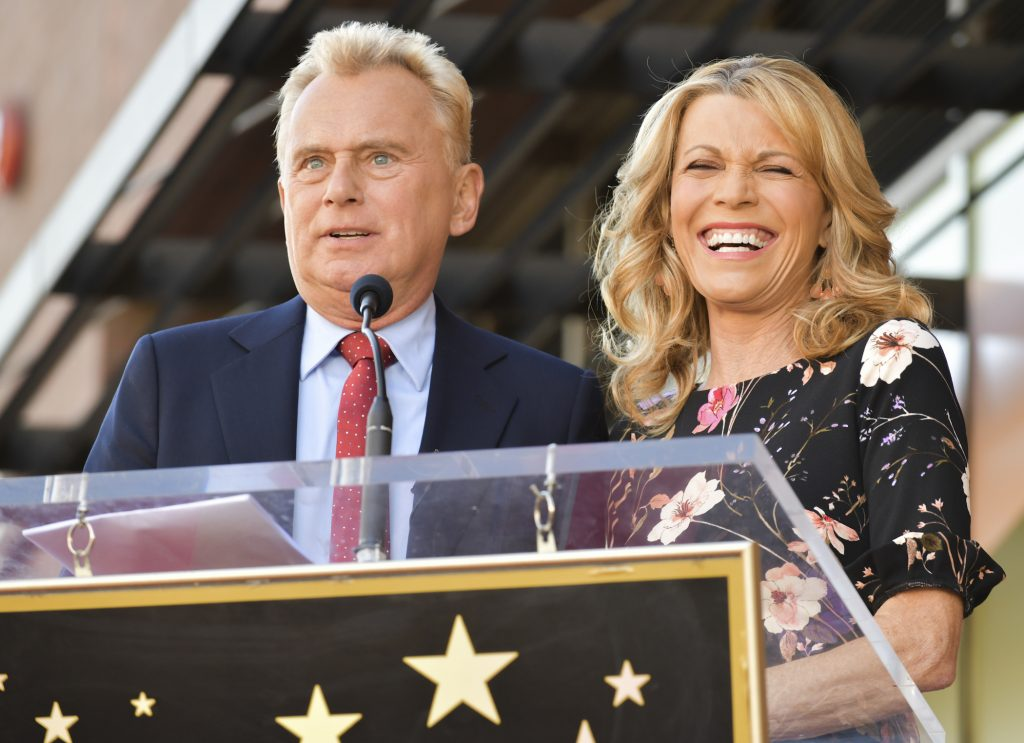 Pat Sajak and Vanna White from 'Wheel of Fortune' smiling at the Hollywood Walk of Fame