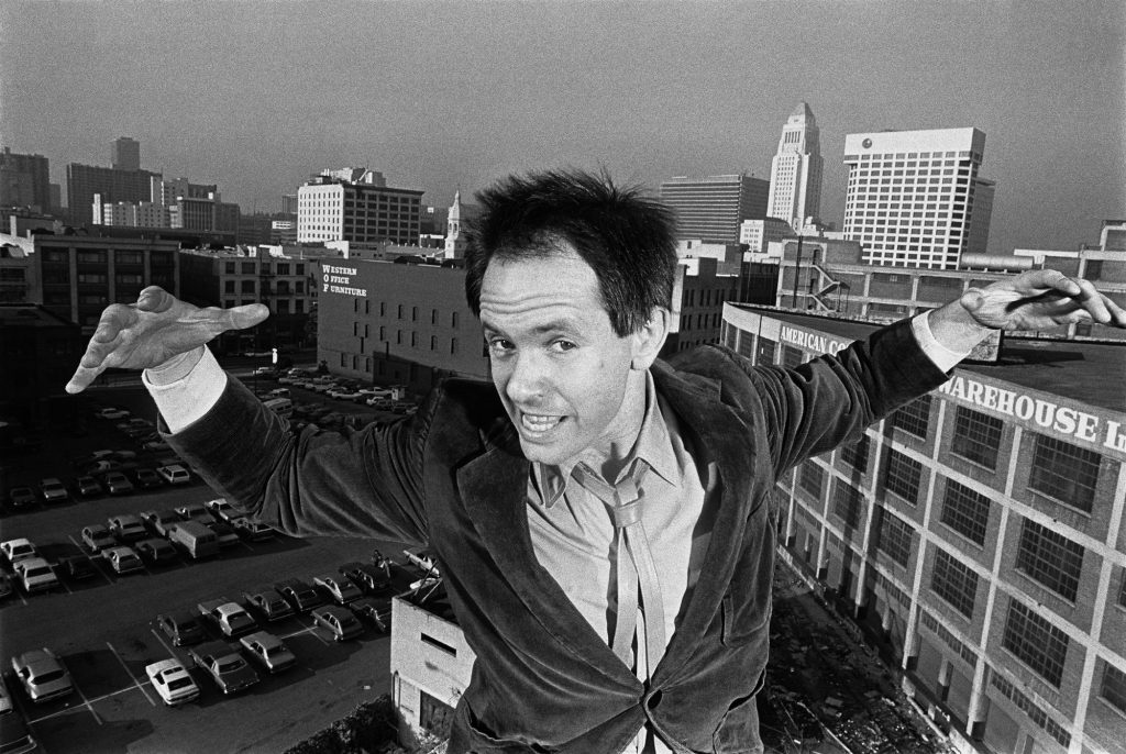 Peter Ivers playfully poses on the roof of his apartment