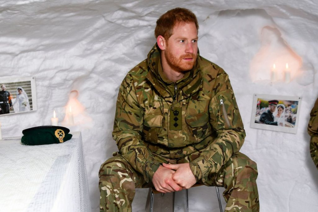 Britain's Prince Harry, Duke of Sussex, sits in a snow cave made by British military personnel